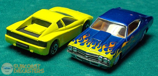 Ferrari Testarossa, a transitional Corgi casting issued by Hot Wheels. The blue Malibu with flames is a Jada, from Big Rob's son Robby
